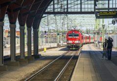 Red train Snalltaget Transdev Sweden trainstation platform passengers mobility company